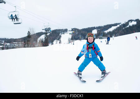 Smiley little boy (5) at ski resort - Stock-Bilder