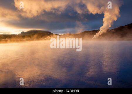 Sunset light on the streaming geothermal vents at Bjarnarflag, Myvatn, Nordhurland Eystra, Iceland. - Stock Image
