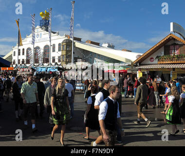 Munich Oktoberfest in Germany  Volksfest beer festival and travelling funfair with crowds - Stock Image