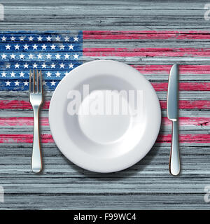 American cuisine food concept as a place setting with knife and fork on an old rustick wood table with a symbol - Stock-Bilder