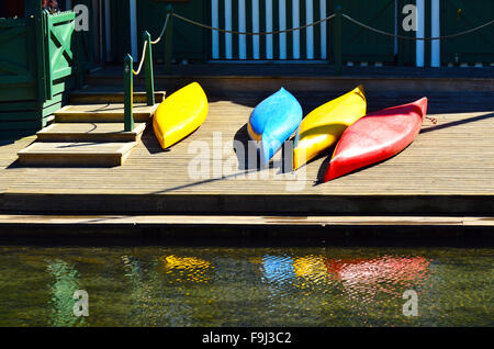 Colourful kayaks on a wooden pier. Summer vacation concept - Stock-Bilder