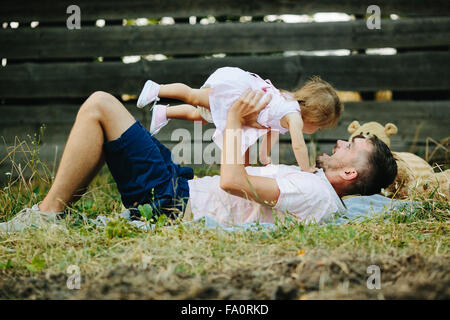 Happy family on lawn in the park - Stock-Bilder