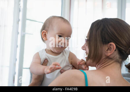 Cute little baby boy playing with his mother at home, Munich, Bavaria, Germany - Stock Image