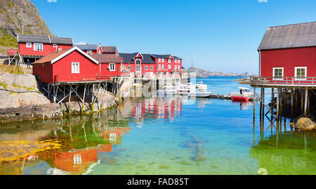 Traditional red wooden rorbu houses on Moskenesoya Island, Lofoten Islands, Norway - Stock-Bilder