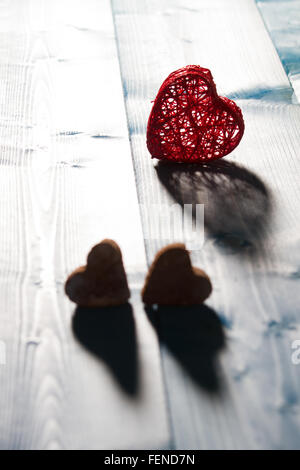 Three Heart Shaped Objects On Table - Stock Image