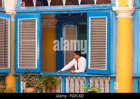 Cuban Man Leaning On Opening Of El Patio Restaurant In Plaza De La Catedral  At Havana