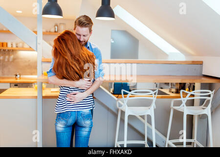 Beautiful couple happy for their new home and hugging after moving in - Stock-Bilder