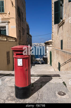 British-style red post box at the top of a steep steps in Valletta, capital of the island state of Malta in the - Stock Image