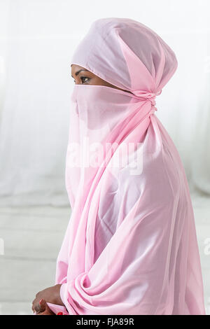 Beautiful  black african muslim woman wearing pink headscarf - Stock-Bilder