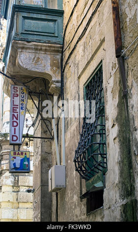 Old bar sign in Strait Street, Valletta, capital of Malta. The notorious street was nicknamed 'The Gut' - Stock Image