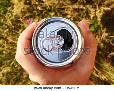 Cropped Hand Holding Drink Can - Stock Image
