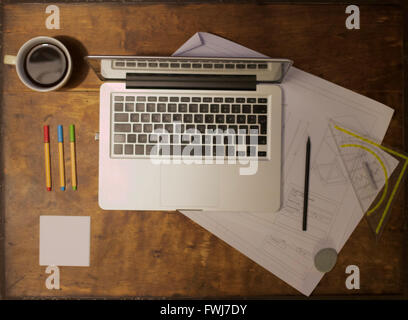 Directly Above Shot Of Laptop With Blueprint And Coffee Cup On Table - Stock-Bilder
