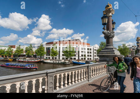 Opera House, Canal Boats, girls with bicycle,  Amsterdam, Netherlands - Stock-Bilder