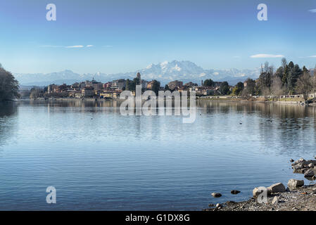 River Ticino and glacier of Monte Rosa seen from Sesto Calende in a beautiful afternoon of spring. - Stock Image
