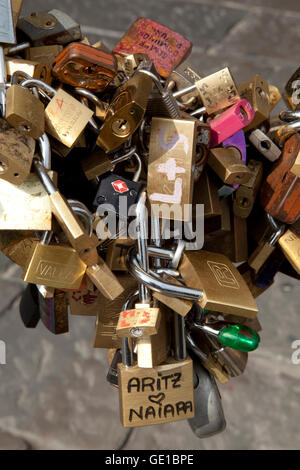 Locks of love hang near the Ponte Vecchio in Florence, Italy. - Stock Image