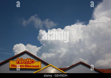 rising stormclouds above Netto Marken-Discount supermarket building.Bavaria, Germany, Europe. Photo by Willy Matheisl - Stock Image