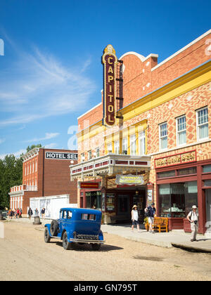 A vintage car in front of the Capitol Theatre on 1920 Street at Fort Edmonton Park in Edmonton, Alberta, Canada. - Stock Image