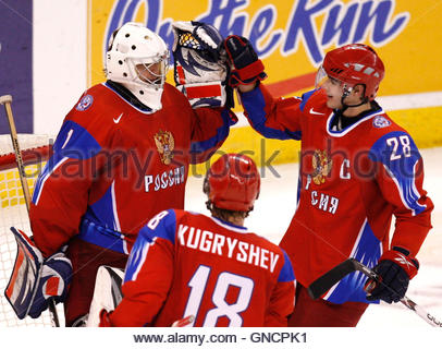 Russia's goalie Vadim Zhelobnyuk celebrates with Nikita Filatov (R) after their win over the Czech Republic - Stock Image