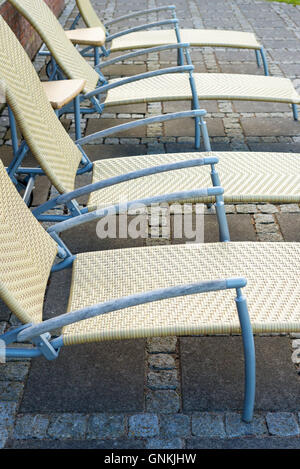Minimalist Danish style of empty sun lounger seats - Stock Image