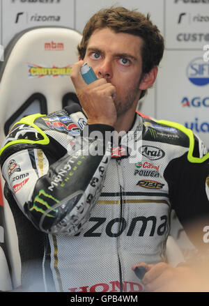 Great Britain's Cal Crutchlow of LCR Honda in the garage before Free practice 3 at Silverstone, Northamptonshire. - Stock Image