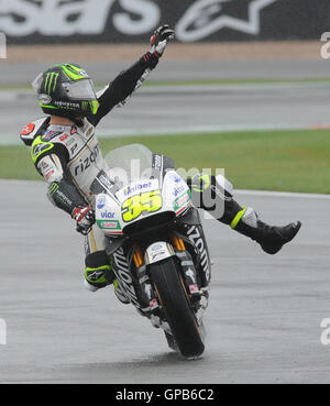 Great Britain's Cal Crutchlow of LCR Honda waves to fans after qualifying in pole position for MotoGP at Silverstone, - Stock Image