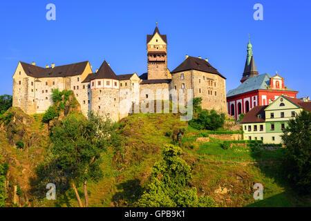 Loket Castle on sunset, Czech Republic - Stock-Bilder
