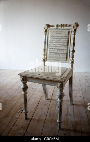 Antique Chair Artistically Restored, Sheet Music - Stock-Bilder