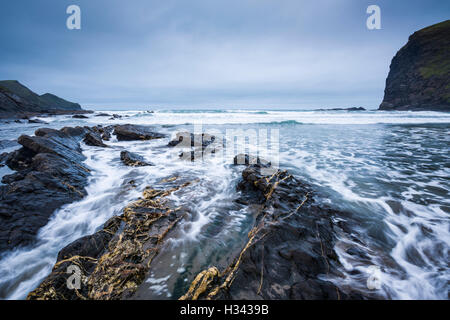Crackington Haven beach with the headland of Cambeak and Pencannow Point beyond Cornwall, England. - Stock Image