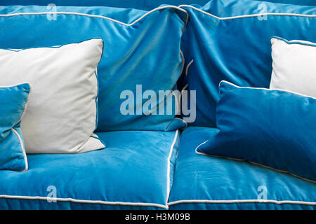 Sofa detail in blue tone with cushions. Horizontal - Stock Image