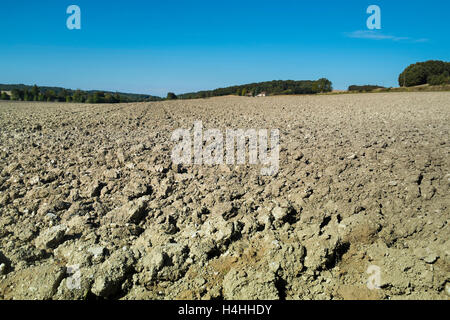Turned soil surface of farm field - France. - Stock Image