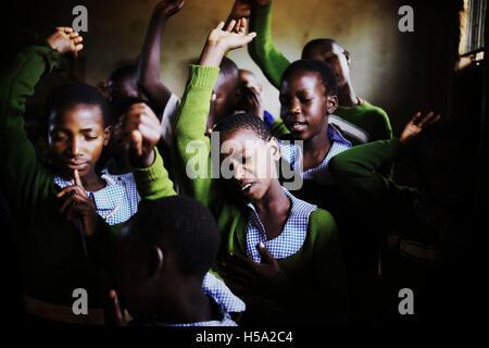 Morning prayer in Rural Uganda East Africa - Stock Image