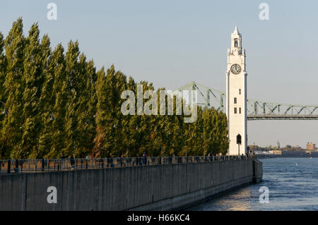 The Clock Tower located on Quai de Horloge with the Jacques Cartier Bridge in back, Old Port of Montreal, Quebec, - Stock-Bilder