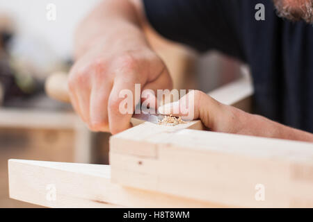 Close up detail of a furniture maker using a chisel - Stock-Bilder