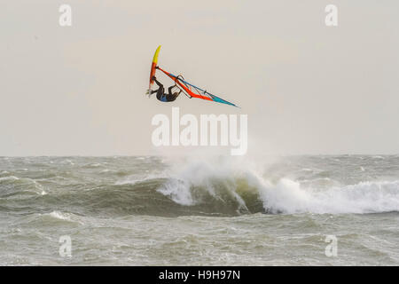 Weymouth, Dorset, UK.  24th November 2016.  UK Weather.  A windsurfers taking advantage of the strong winds and - Stock Image