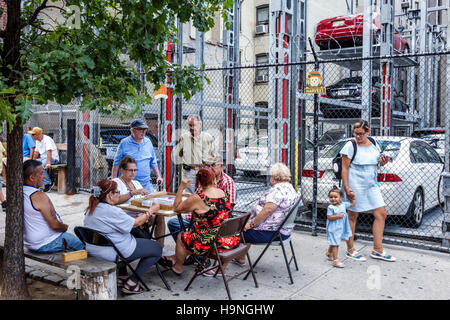 Manhattan New York City NYC NY East Harlem El Barrio Spanish Harlem immigrant neighborhood parking garage sidewalk - Stock Image