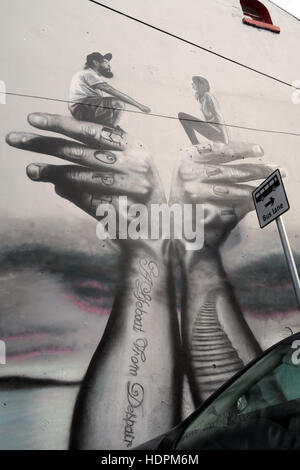 Belfast Falls Rd Republican Mural- Hope Love on hands - Stock Image