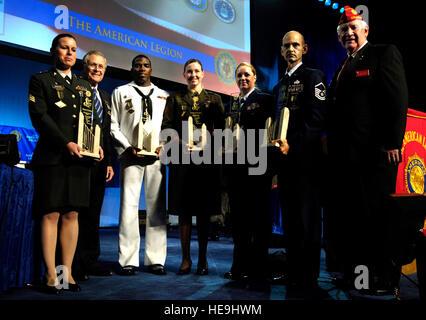 Left to right, U.S. Army Sgt. Renee E. Kraus, U.S. Defense Secretary Donald H. Rumsfeld, U.S. Navy Petty Officer - Stock Image