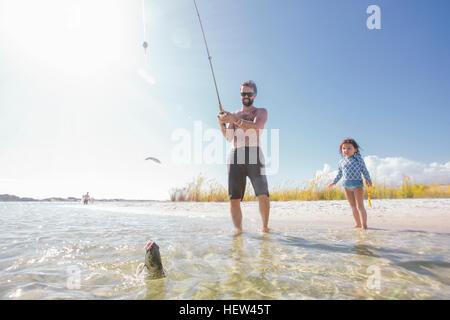 Catching fish deep sea stock photos catching fish deep for Fort walton beach fishing