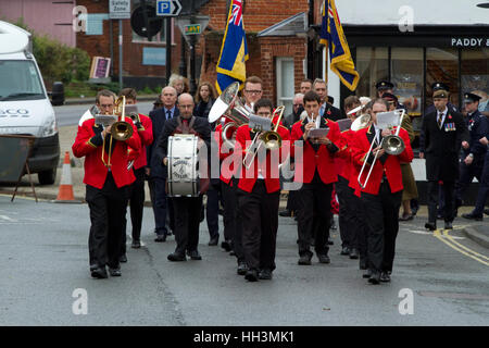 Members of the Woodford Excelsior brass band on a remembrance day parade - Stock Image