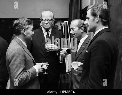 Left to right. Sir Walter Hayes, Sir Patrick Hennesey, Colin Chapman, Graham Hill - Stock Image