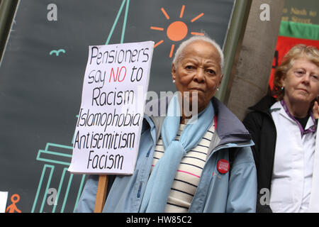 London, UK. March 18, 2017: A pensioner holds up her placard ahead of  the Stand Up To Racism demonstration on UN - Stock Image