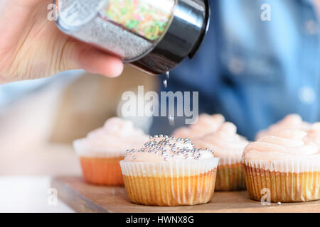 Woman Decorating Cupcakes woman baking cakes stock photos & woman baking cakes stock images
