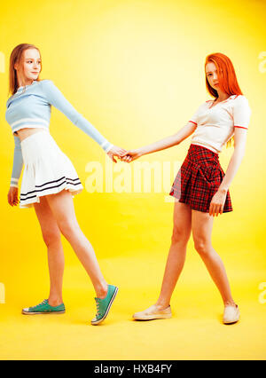 lifestyle people concept: two pretty stylish modern hipster teen girl having fun together, happy smiling making - Stock Image