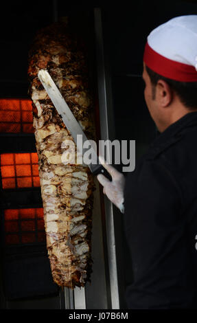 Cutting Shawarma in a popular restaurant in Aqaba, Jordan. - Stock Image
