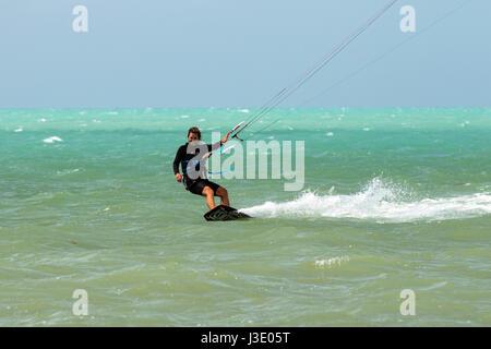 Woman kitesurfing at Coco Plum Beach, Marathon Key, Florida, USA - Stock Image