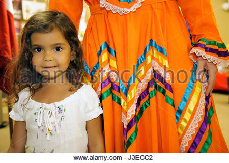 Miami Florida Miami Art Central Festival Mexico Miami Jalisco dress outfit Hispanic woman girl child teach play - Stock Image