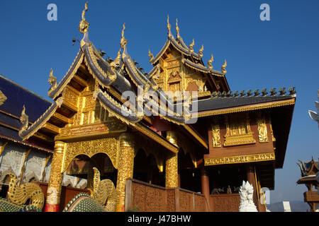 The magnificent Lanna-style teakwood viharn (sermon hall) at the Buddhist temple complex of Wat Ban Den, Mae Taeng, - Stock-Bilder