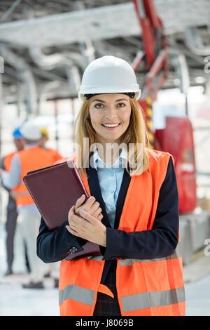 Portrait smiling female engineer at construction site - Stock-Bilder