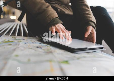 Cropped shot of female backpacker using digital tablet touchscreen on railway platform - Stock-Bilder