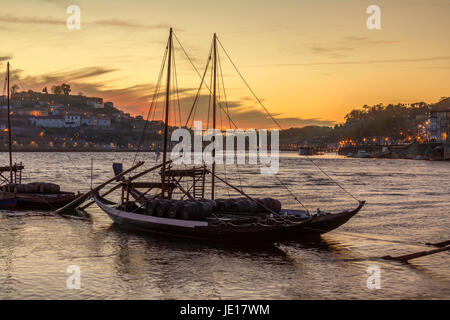 Port Wine boats moored on the River Douro in Porto (Oporto) in Portugal. - Stock Image